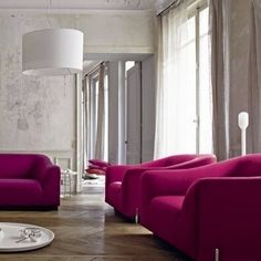 Can't you just see Marilyn lounging on one of the chairs in this swanky sitting area? Barely-there gray on the walls lets the magenta upholstery steal the spotlight.