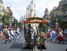 Walking right down the middle of Main Street USA. The trolley show, I love the trolley show!