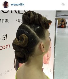 Low swirl bun hairstyle with big swirls on top