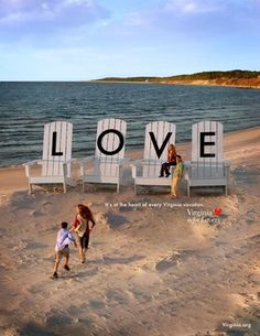 Giant Adirondack chairs spell out LOVE at Kiptopeke State Park on Virginia's Eastern Shore.