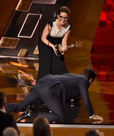 Jon Hamm actually crawled on stage to accept his award for outstanding lead actor in a drama series for Mad Men from Tina Fey after being nominated  seven times - red carpet