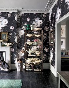 Dramatic living room with dark floral wallpaper