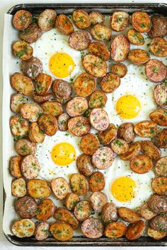 Sheet Pan Breakfast - Toss everything onto a sheet pan for perfectly cooked eggs and crispy roasted Parmesan potatoes! No more fussing on the stovetop!