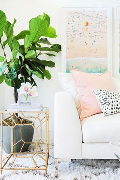 Gray Malin | Home Decor on Life With Me | Marianna Hewitt apartment by Amber Lancaster Interiors | Mongolian fur pillows, sectional couch, fiddle fig tree, gold side table, target, lulu and georgia