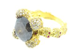 18K yellow gold 7.10ct opaque diamond ring with 4-skull prong and skull band with .83cts diamonds and .20cts rubies.  $20,500