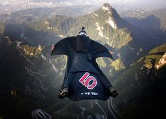 Contest of flying people held in China Wingsuit flying is the sport of flying through the air using a special jumpsuit, called a wingsuit, which adds surface area to the human body to enable the wearer to  fly . The contest on Tianmen Mountain was the first of its kind and featured 15 athletes wearing wingsuits jumping off a cliff and then completing a 1.2-km-long obstacle course while flying, according to the World Wingsuit League, one of the organizers of the contest, chinadaily.com.cn…