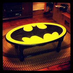 Batman coffee table. I need this for my nerd home. This would be easy to do, actually.