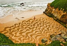 Artist Andres Amador carves intricate artworks in the sand – only for them to be washed away by the sea just hours later. He uses Google earth to pick out the best location for his designs - some spanning 300 by 500 ft.