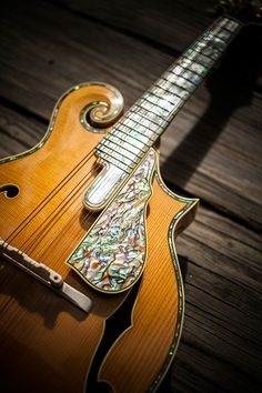 A mandolin with mother-of-pearl and abalone inlay and an ivory bridge by Georgia luthier Randy Wood