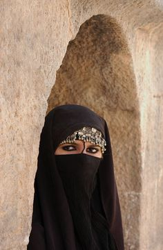 A Saudi woman wearing a more modern form of abaya, which unlike in the past is no longer just plain black, but is now embroidered and bejewelled.