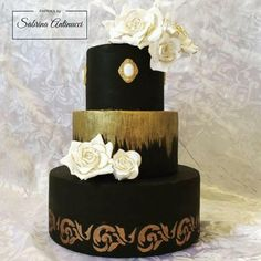 Black and gold wedding cake by Sabrina Antinucci - http://cakesdecor.com/cakes/285498-black-and-gold-wedding-cake