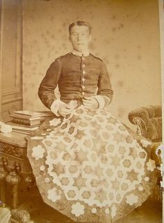 """[I was given this wonderful original Victorian photo showing a young soldier proudly pictured with his patchwork quilt. """"Soldiers were encouraged to take up sewing as a valid alternative to the less salubrious pursuits of drinking and gambling; needlework was also used as a form of therapy for those injured in conflict and recuperating in hospital"""". V&A article below: http://www.vam.ac.uk/content/articles/m/military-quilt/ ]"""