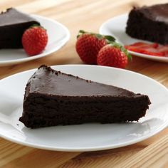 Flourless chocolate cake topped with dark chocolate ganache is a gluten-free and very decadent dessert.