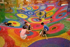 In the mid 1990s Japanese artist Toshiko Horiuchi MacAdam was showing a large scale crochet artwork at an art gallery when two rambunctious children approached her and asked if the sculpture, resembling a colorful hammock, could be climbed on. She nervously agreed and watched cautiously as her suspe