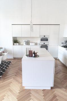 Ceramic tops, new wooden floor, part of kitchen hidden in wall.