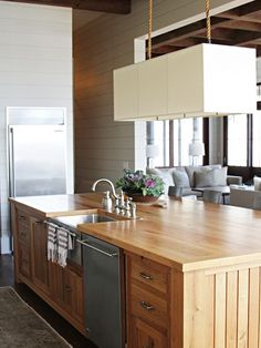 """The most eye catching thing in the kitchen is the """"island kitchen"""" being placed in the centre which have different style of chairs, storage space and various styles of lamps on the top of the countertops.Kitchen is that place where you have to think thousand times as what, where and how to store the things. …"""