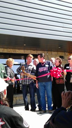 Cutting the ribbon to the Clint Bowyer, community building.