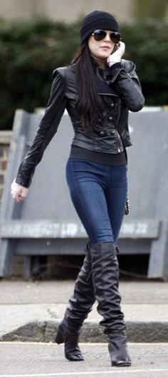 Who made Linsday Lohan's studded black purse and jean leggings that she wore in London, England?