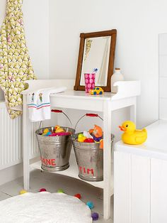Use galvanized-steel buckets as a catchall for kids' bath gear. Personalize them with paint for a cute look.