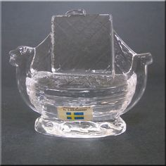 Lindshammar Swedish clear glass ship paperweight, labelled.