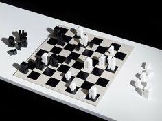 El diseñador Jim Sutherland de hat-trick ha creado un juego de ajedrez en el que los trebejos son las iniciales de las piezas en idioma inglés. El tipo de letra elegido fue la Champion Gothic.  Se hizo una edición limitada de 50 juegos, realizados en acrílico. Como curiosidad, en los folletos que acompañan al tablero, además de la información técnica habitual, se incluye una serie de citas de contenido ajedrecístico.