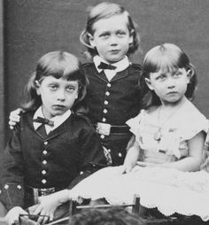 The three eldest children of Bertie and Alexandra:  Prince Albert Victor, Duke of Clarence, Prince George (later King George V), and Princess Louise, the Princess Royal and later Duchess of Fife.  Love the long hair on the boys!