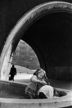 """""""Two children quarrelling in an archway""""..Quarry Hill Flats, Leeds 1954. Photo by Marc Riboud.."""