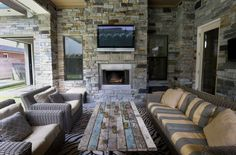 Outdoor livingWith a couple of couches, a TV, an outdoor kitchen and a fireplace, there may never be a reason to go inside again. Photo: Jon Shapley, Staff / © 2015  Houston Chronicle