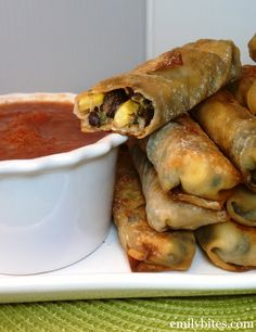 Skinny Southwestern Egg Rolls ~  corn, spinach, black beans, seasonings in a wonton wrapper and baked!