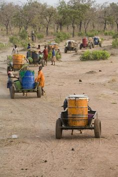 A long journey for safe drinking water, taken in 2008 in Tamale, northern Ghana.  The safe water supply  at a distant public tap is only open twice a week.  // by Gates Foundation