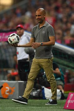 Pep Guardiola Photos Photos - Pep Guardiola the manager of Manchester City controls the loose ball during the pre season friendly match between Bayern Muenchen and Manchester City F.C at the Allianz Arena on July 20, 2016 in Munich, Germany. - Bayern Muenchen v Manchester City F.C.  - Friendly Match