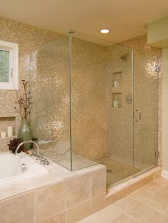 Shower with mosaic wall that flows over tub too