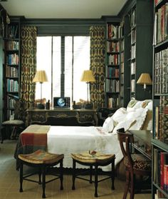 So cozy, and so anglo in this deep green library-turned-guest bedroom.