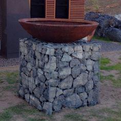 Gabion plinth with rusty bowl by clint.kenny.design