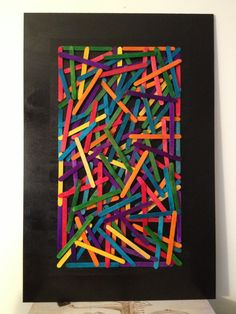 Colorful Popsicle stick wall art by CleverLew on Etsy, $31.00
