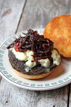 Portobello Burger with Blue Cheese and Sauteed Red Onions  I added black beans, BBQ sauce & a dash of liquid mesquite.