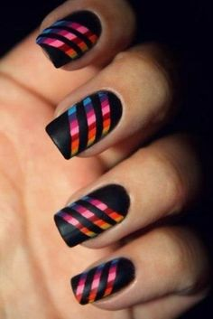 I made a simple striping tape nail design and kept the colors somehow neutral with a little bit of shine.