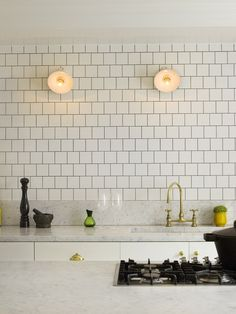 Design: Charles Mellersh. Photo: Chris Tubbs. I like the utilitarian feel. Marble tops , brass faucet, using 4x4 tiles again to the ceiling, no uppers and those lights!