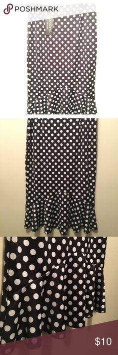NWT ladies polka dot midi skirt Reposh! This says L but fits like a small. A medium could fit if you wear it tight on the rump. I'm a medium and it fit me everywhere but the back side where I'm abundantly blessed. 😝 This is a nice thicker, satiny type material. Fit and flare midi style. Black with white polka dots. Pet free smoke free home. ❤️❤️ Skirts Midi