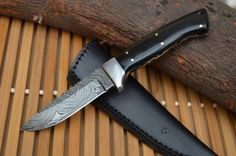 Twisted Damascus knife with Buffalo Horn and steel bolster...
