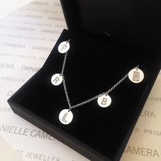 Made to order personalised multi- disk necklace with initials in melee diamonds Jewelry Art, Jewelry Rings, Silver Jewelry, Fine Jewelry, Jewelry Design, Disc Necklace, Initial Necklace, Buying An Engagement Ring, Engagement Rings