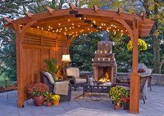 pergola ideas. love the stone fireplace. #pergolafireplace