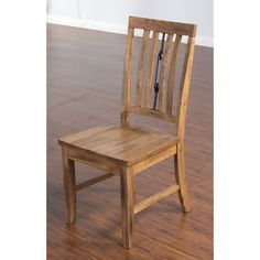 This Sunny Designs Sedona turnbuckle back chair with wooden seat will add rustic charm to your home. The simple design of the chair is embellished by the turnbuckle back. The oak finish and solid cons