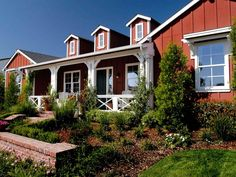 Barn Red Exterior | barn style ranch home with spacious front porch white porch detailing ...