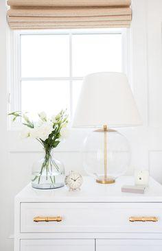 Clean, streamlined, white bedside table design inspiration.