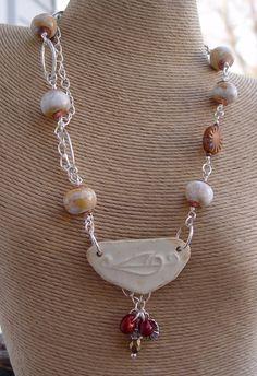 Handmade Stylized Leaf Stoneware, Peach Porcelain Silver Necklace. $59.50, via Etsy.