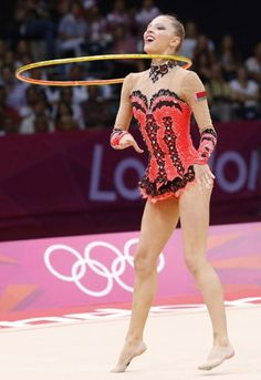 This Belarussian gymnast hit the floor in this red and black burlesque-style leotard.  Best rhythmic gymnastics outfits of the London 2012 Olympics