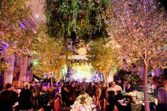 "Van Wyck & Van Wyck transformed the Plaza's Grand Ballroom into a fantastical forest. ""Our color scheme was '50 Shades of Green!'"" jokes Melissa. The ballroom entrance, decorated with moss and grapevine, ""felt like a secret passageway,"" she says. Inside, boxwood hedges lined the perimeter, faux grass carpeted the floor, and the stage curtain was hand-painted to resemble Monet's garden. """