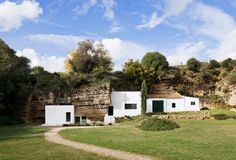 At the foothills of Sierra Morena, Spain / carved out of the calcarenite stone terrain,  Read more at http://homes.nine.com.au/2017/01/19/11/37/rent-this-spanish-home-built-into-a-cave#wuR0fZu9PCZ6UqYW.99