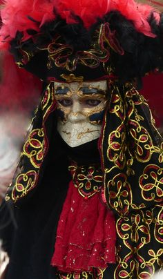 "The bauta (sometimes referred as baùtta) is a mask, today often heavil gilded though originally simple stark white, which is designed to comfortably cover the entire face; this traditional grotesque piece of art was characterized by the inclusion of an over-prominent nose, a thick supraorbital ridge, a projecting ""chin line"", and no mouth. The mask's beak-like chin is designed to enable the wearer to talk, eat, and drink without having to remove it.."